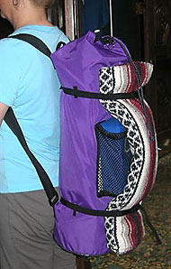 YOPA crossover back pack holds blanket with straps.